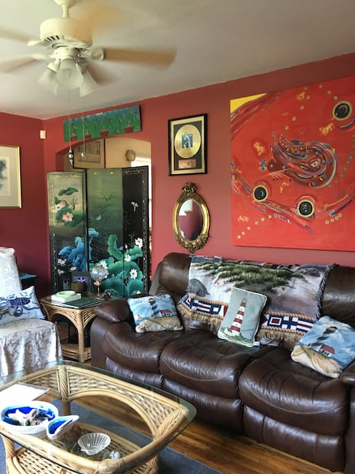 This is the living room couch and tables to relax and read our local magazines