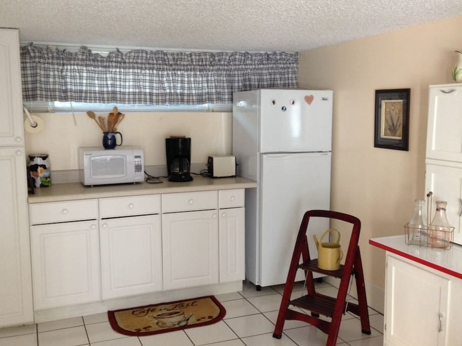 Kitchenette with refrigerator, microwave, coffee maker and toaster