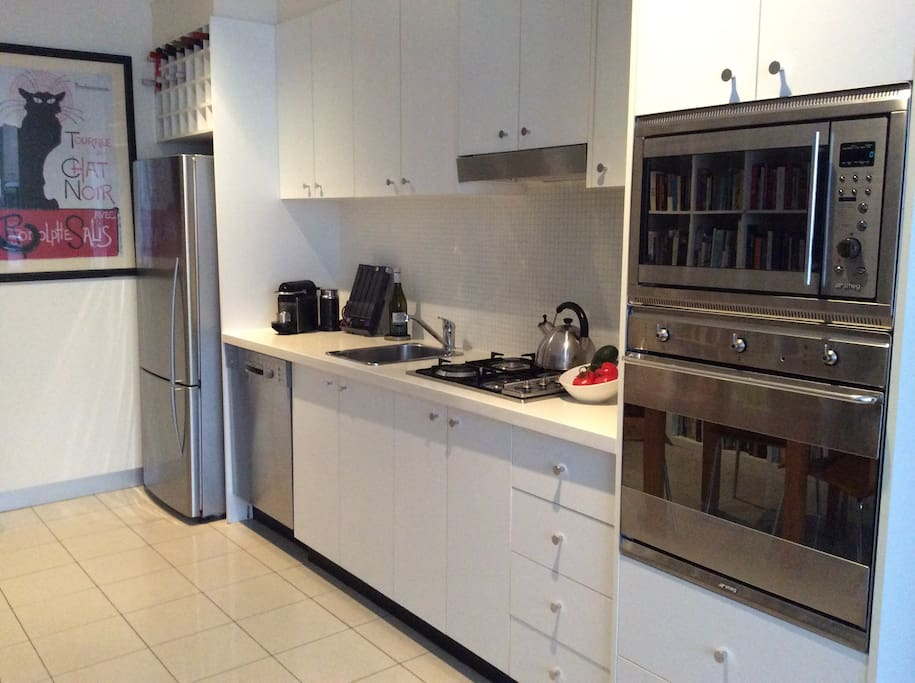 Fully equipped kitchen with Smeg gas stove, oven, microwave , Bosch dishwasher.