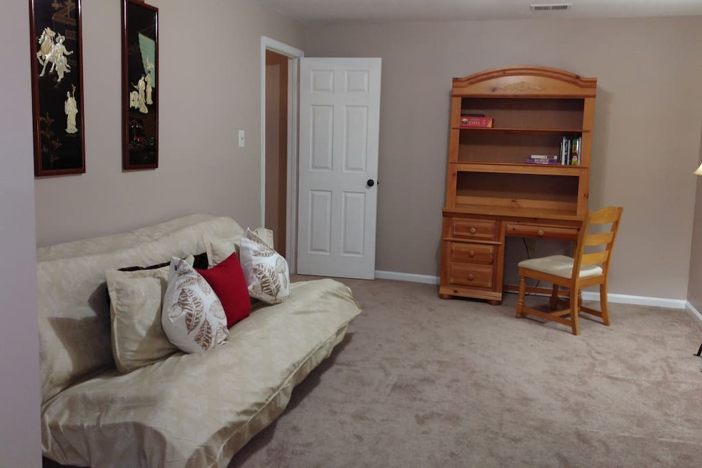 Queen futon in separate area adjacent to Living Room