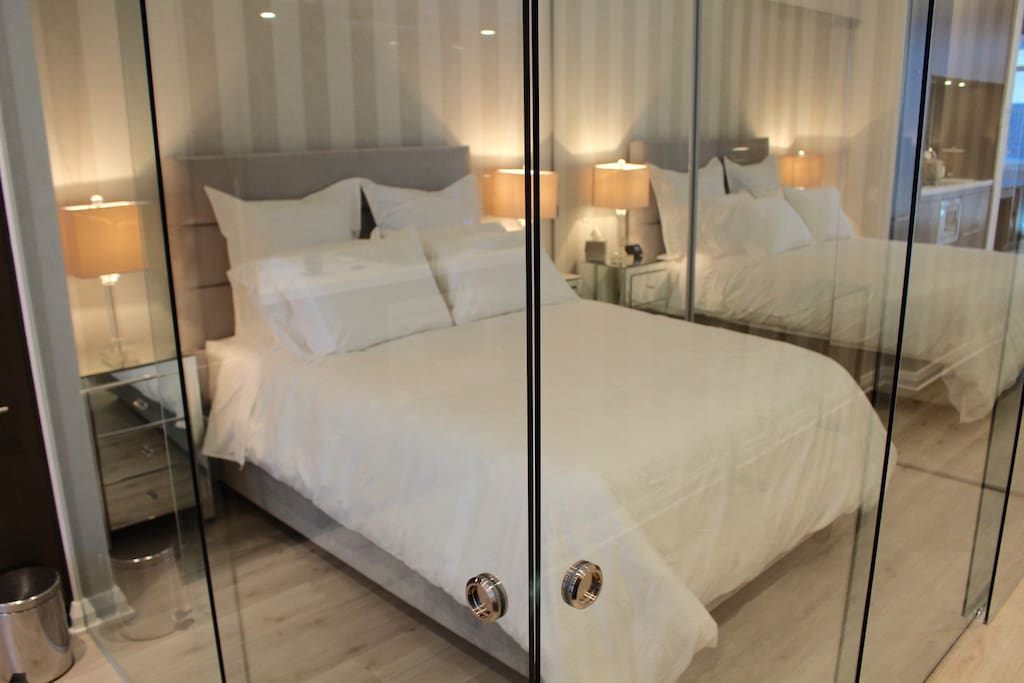 Super comfy Queen Bed with glass privacy walls