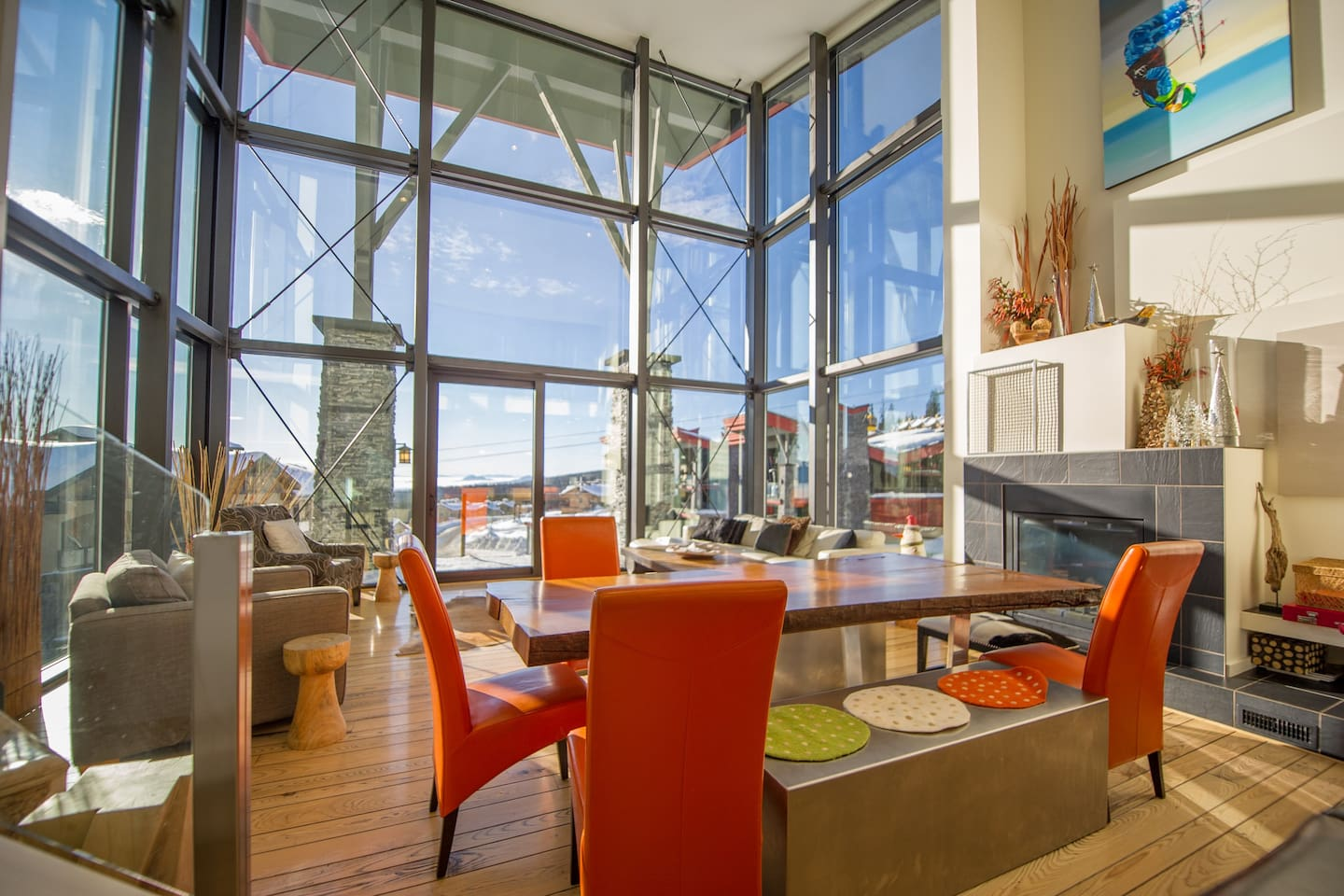 The great room boasts 26' high ceilings in a glass enclosure with sweeping views of the mountain and valley below.