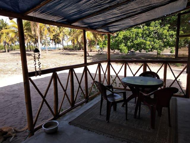 Marzia beachfront cottage (private  bedroom)