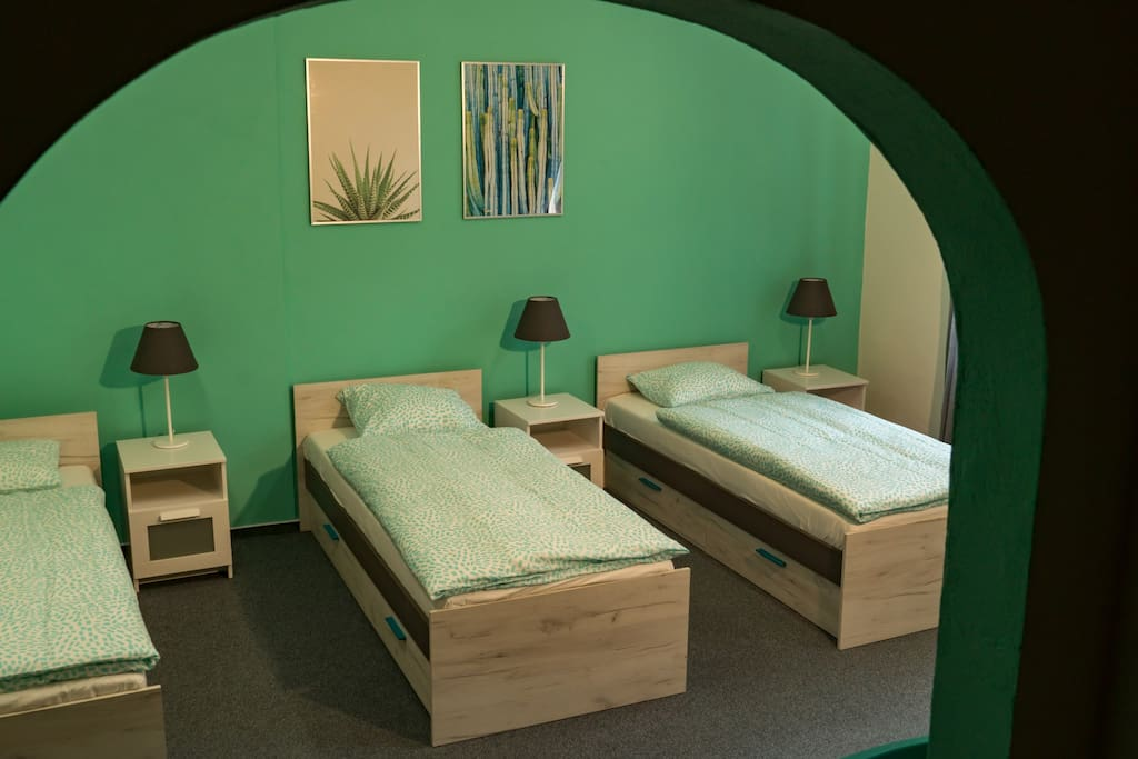 A view of your bedroom with 3 comfortable single beds