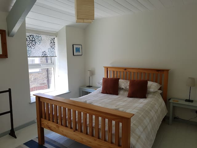 The double bedroom enjoys a sunny southerly aspect