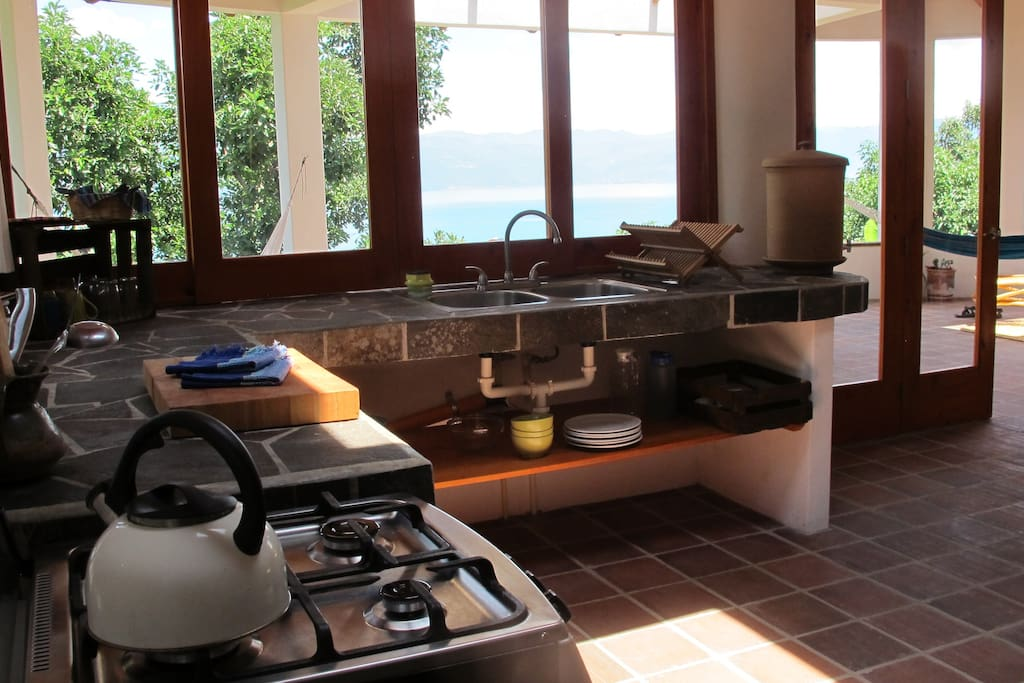 The kitchen comes fully equipped with an oven, full fridge (not pictured), baking sheets, cooking utensils, pots, pans, a pitcher, a kettle, a blender and a cast iron pan.