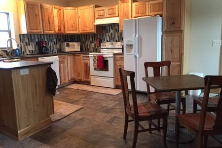 Sunny, second floor, 310 Main St, alley entry