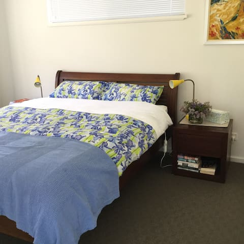 Comfy queen bed with electric blankets and reading lamps plus big wardrobe