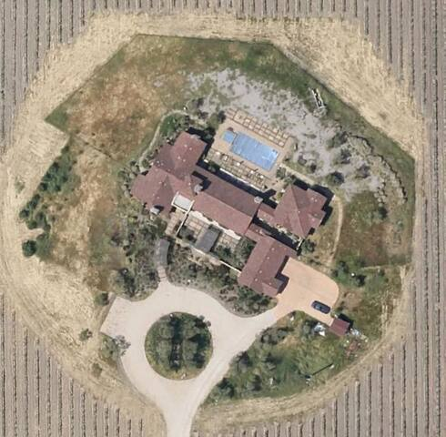 An Oasis Surrounded by 55 Acres of Vineyards