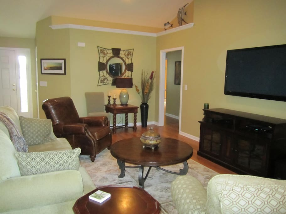 "Spacious, comfortable living room area with 60"" LED TV, full cable package and surround sound"