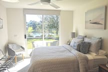 Your bedroom, with views and direct access to garden and lake