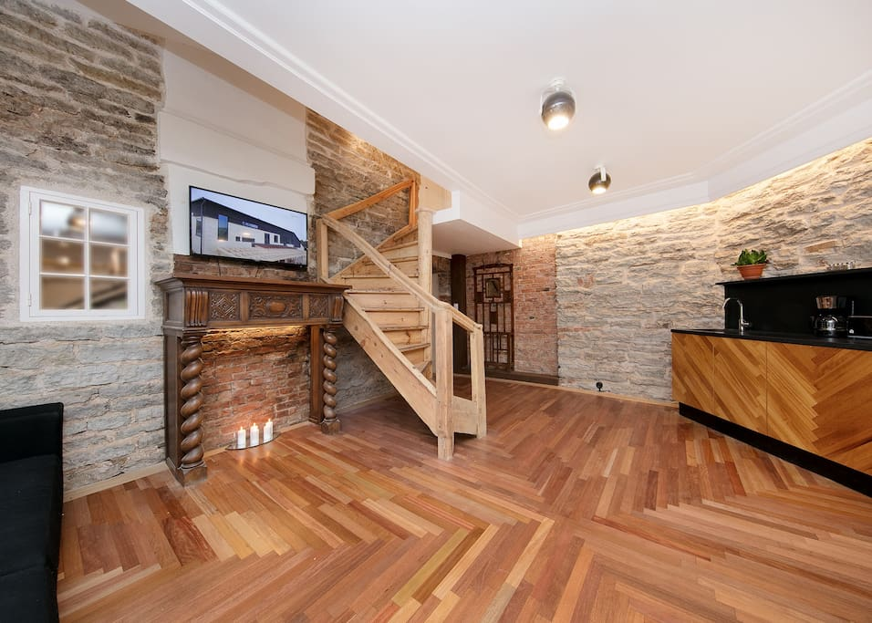 Living room with stairs going to the second floor