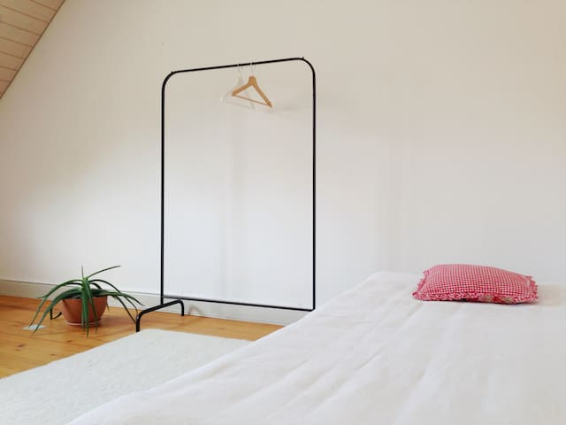 The room is equipped with two mattresses, two tatami futons, a wardrobe and...