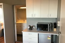 Small kitchenette to warm up food or make breakfast