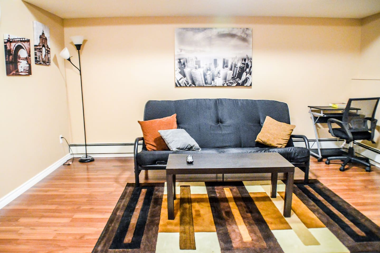 Living room with futon and desk