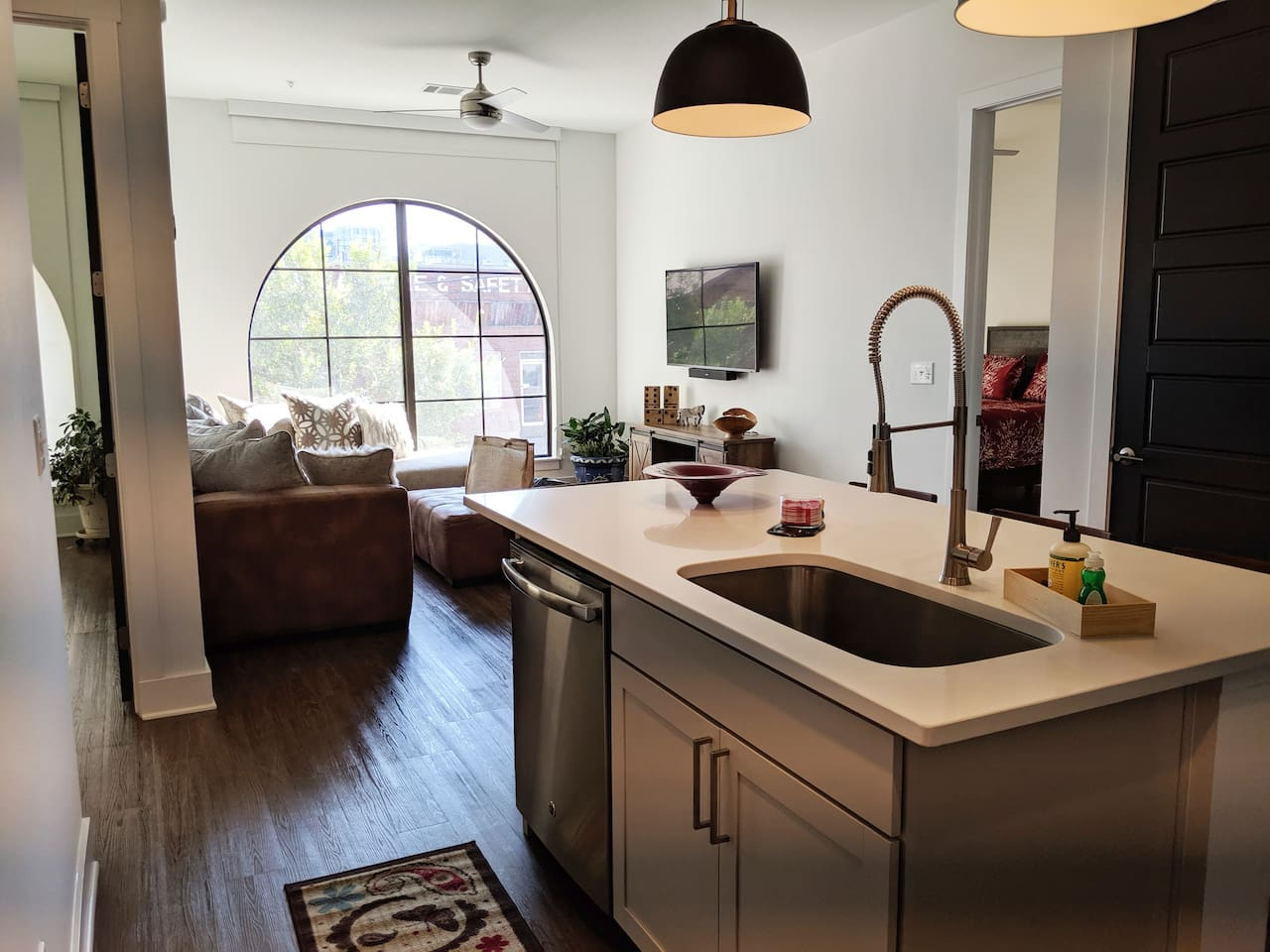 Kitchen with all the amenities: Large sink, dish washer, washing machine and more, all for you to use during your stay with us.