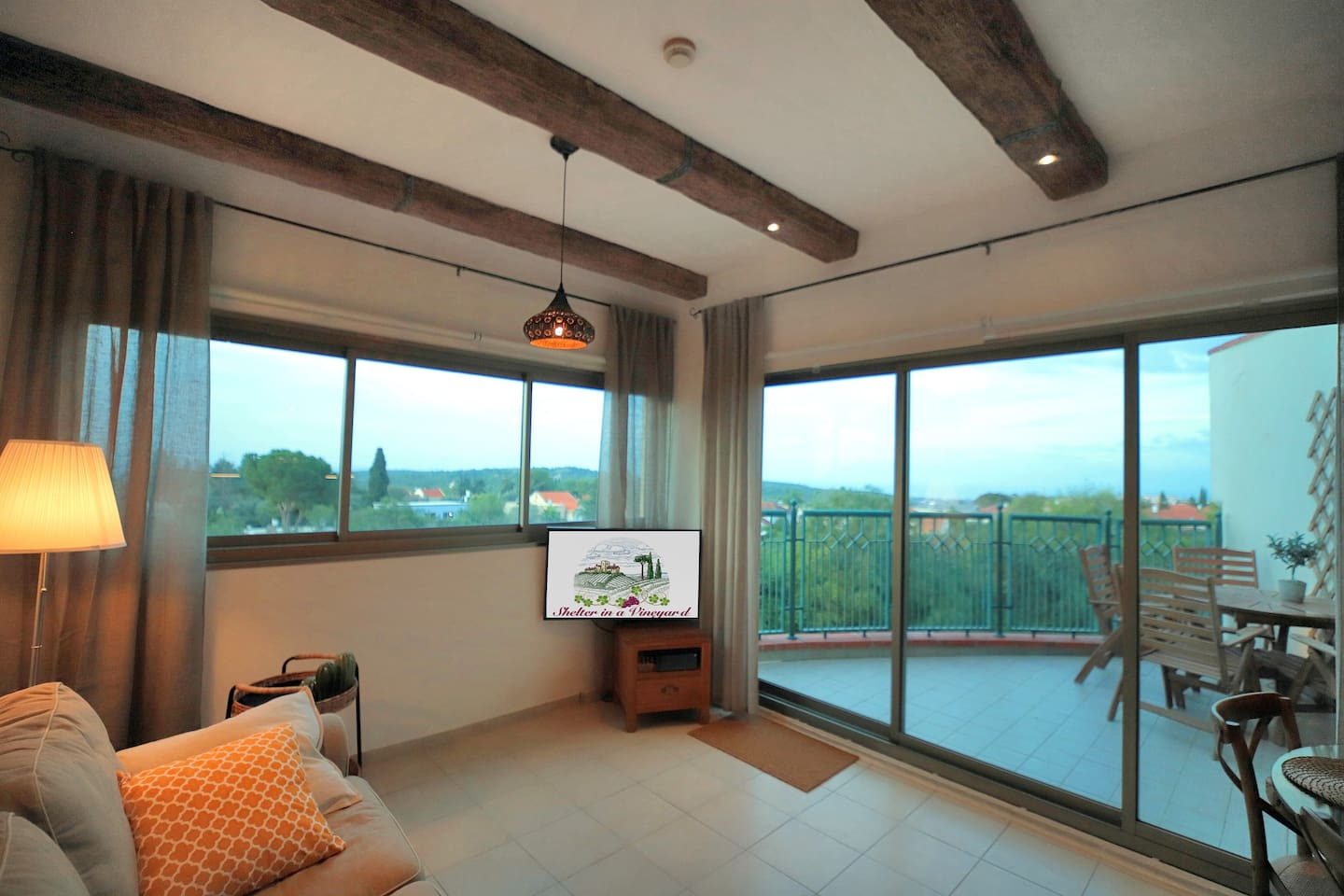 The apartment enjoys a lot of light and panoramic views due to the large windows. It has lovely terrace and wonderful architectural details.