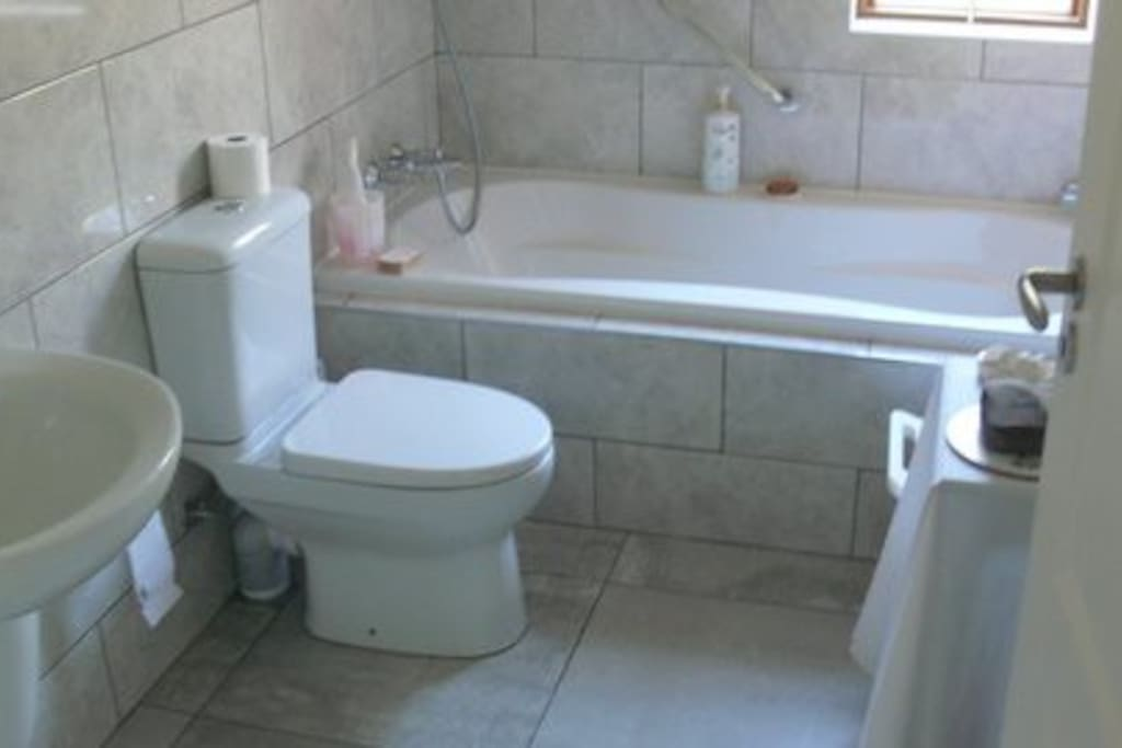 Large Bath with shower handle