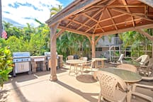 BBQ area features a covered dining area and two gas grills