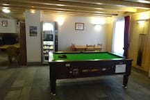 Play a round of pool in the games area.