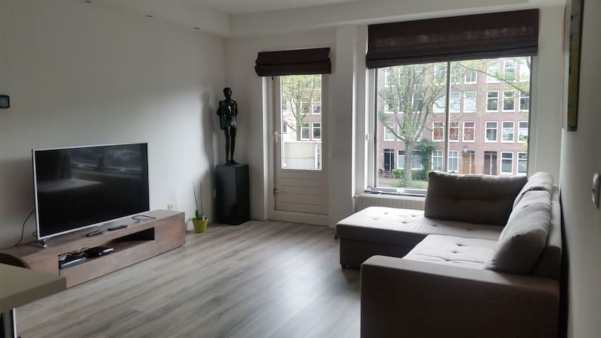 Spacious and light living room facing south with canal view
