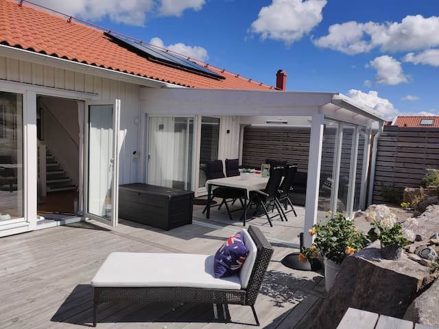 Modern house, hot tub on large patio, close to sea