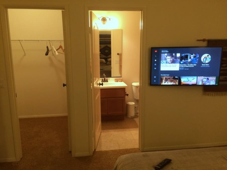 Smart TV, and doors to private bath & closet.