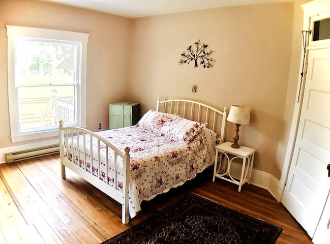 Room 2 features: ~ full-sized bed ~ shared bathroom ~ arm chair ~ dresser ~ beautiful views from 2 windows