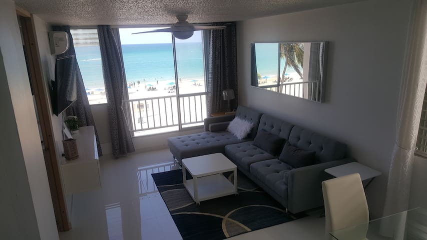 Living room Sofa bed (King) Entertainment Center, TV , A.C., Fan, Sliding doors open to the Beach
