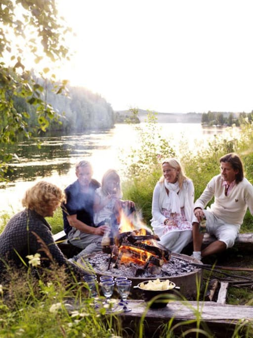 Bake stick bread over the open fire next to the river.