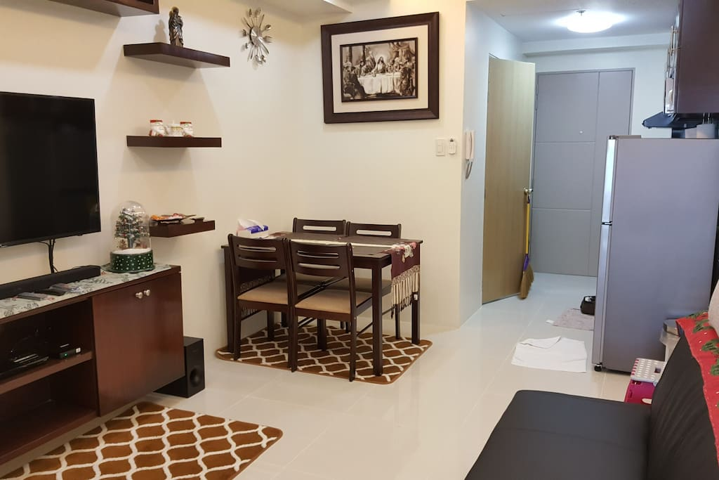 Living room with flat tv with soundbar, blueray player, pldt wifi(5mbps) and tv plus