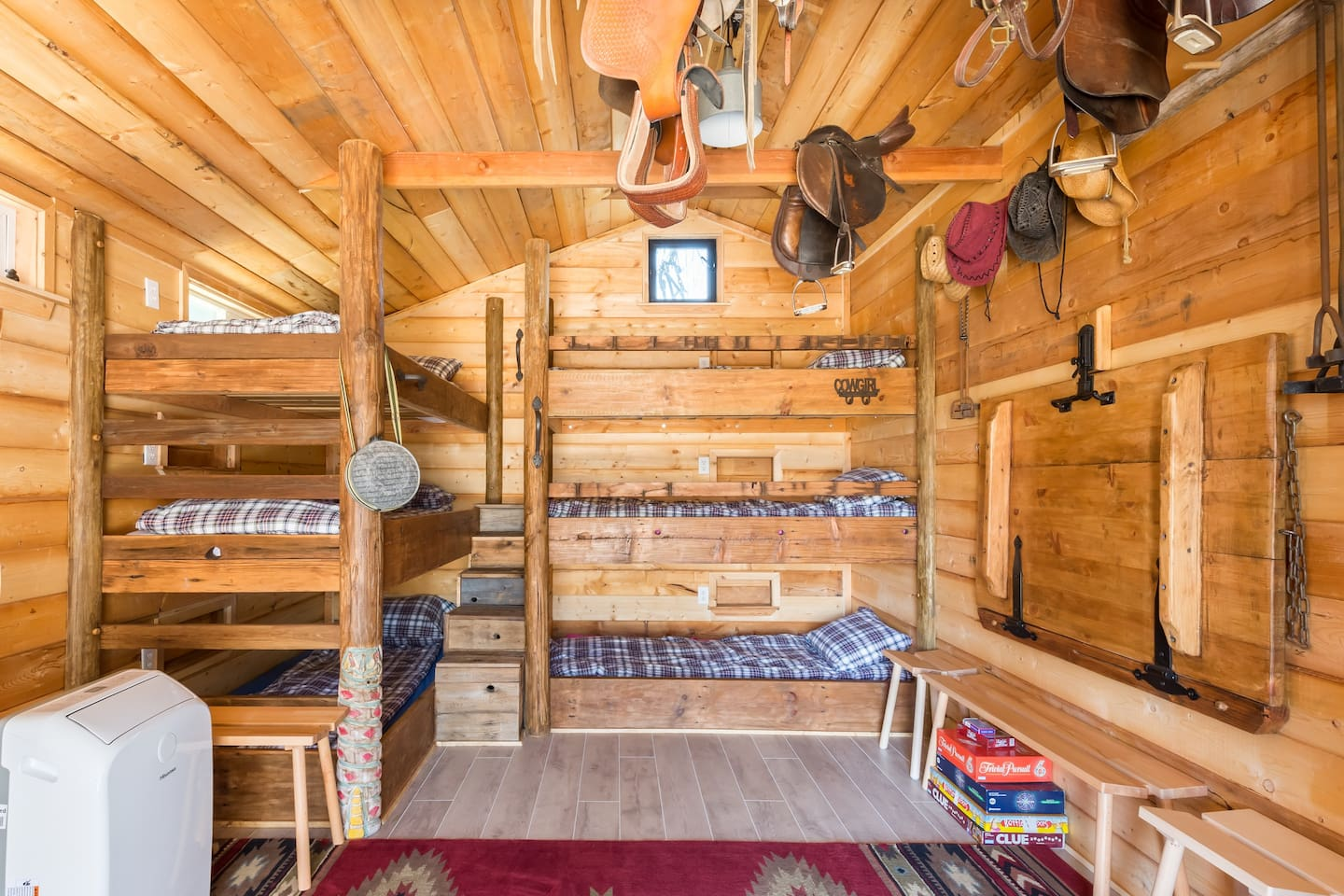 Howdy! Welcome to The Bunkhouse at Capability Ranch. Bed down for the night and get cozy in our super comfy triple bunks.