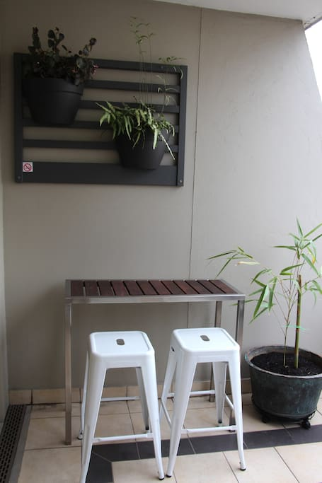 Sit at the bar table for a drink or move it to the balcony rail to watch Melbourne in action.