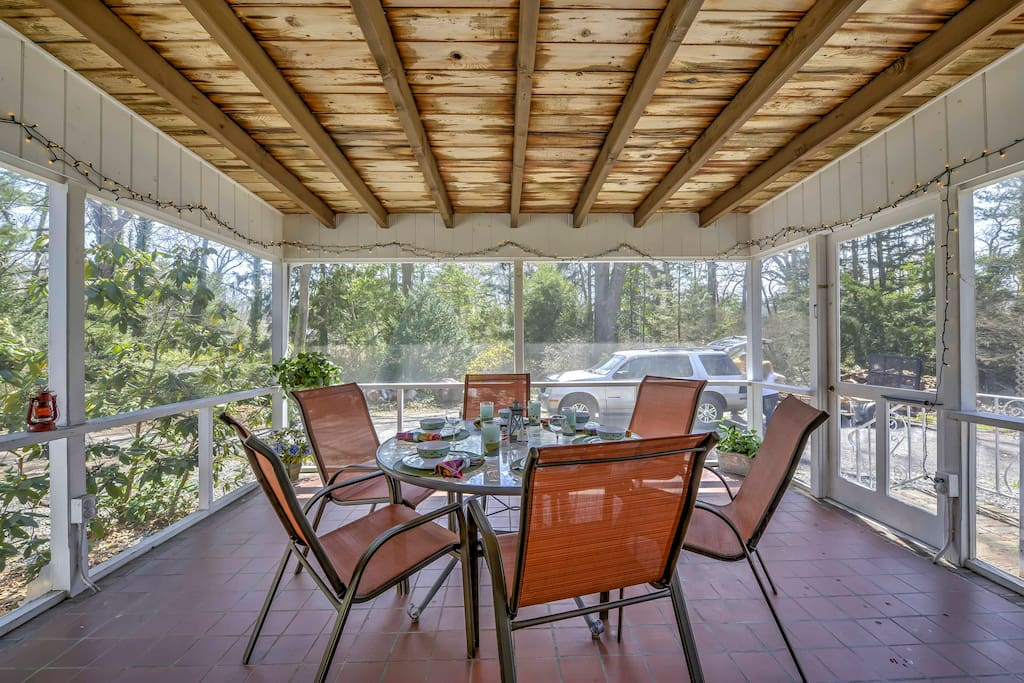 Relish in delicious home-cooked meals gathered around the 6-person dining table in the covered, screened-in porch.