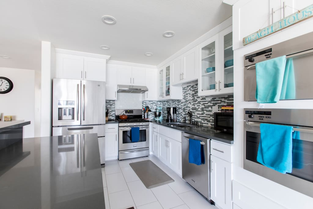 Open concept kitchen with ocean views perfect for you to cook and enjoy your time with family