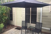 Outdoor area for you to enjoy your breakfast or pre dinner drink Umbrella, table and 2 chairs.