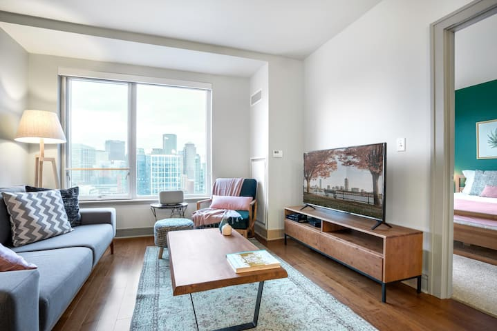 Ample Seaport 1BR w/ Office Nook, Pool + Gym by Blueground