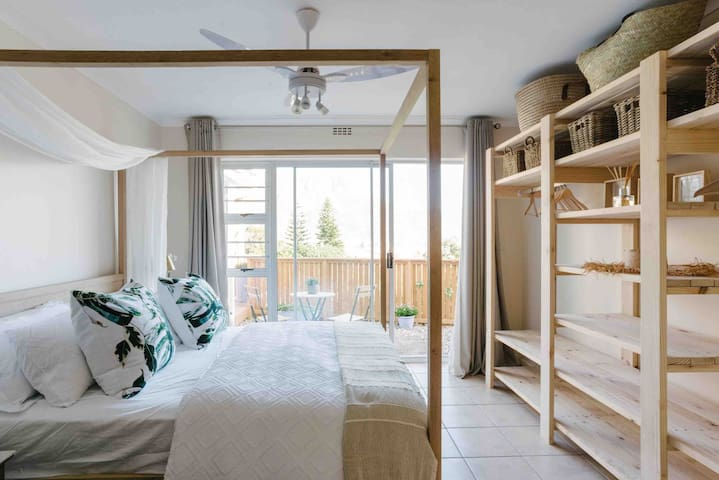 Second double bedroom with sliding door opening onto small courtyard