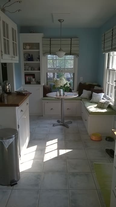 A sunny, eat-in kitchen perfect for your morning coffee.