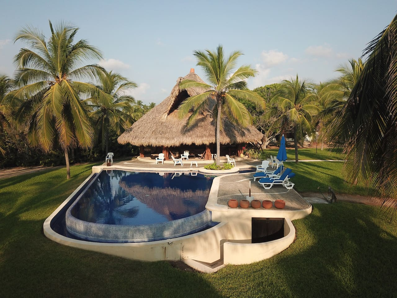Aerial view of the pool and palapa.