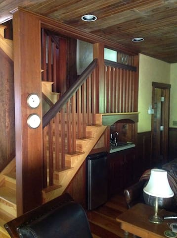 Mini kitchenette , stairs to second floor and third floor loft