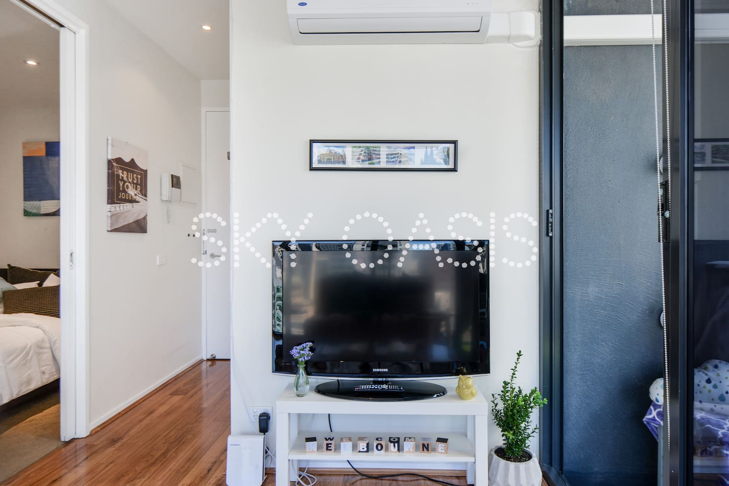 Cozy bright living room with TV including, Air-con, and free unlimited WiFi