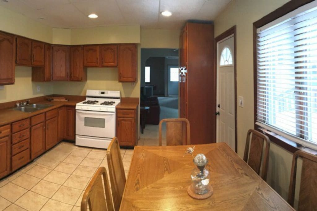 Fully stocked kitchen with recently added coffee maker and microwave!