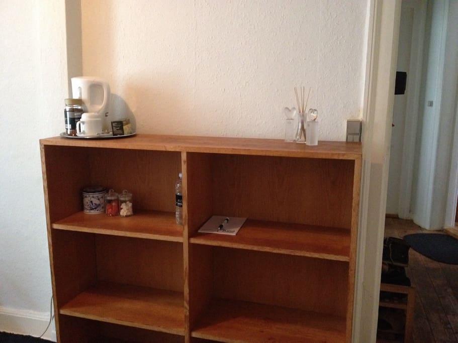 Bookshelf. We provide coffee, tea and some snacks.