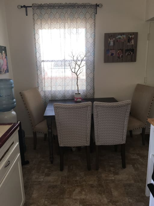 Kitchen Table and Complimentary bottled water dispenser
