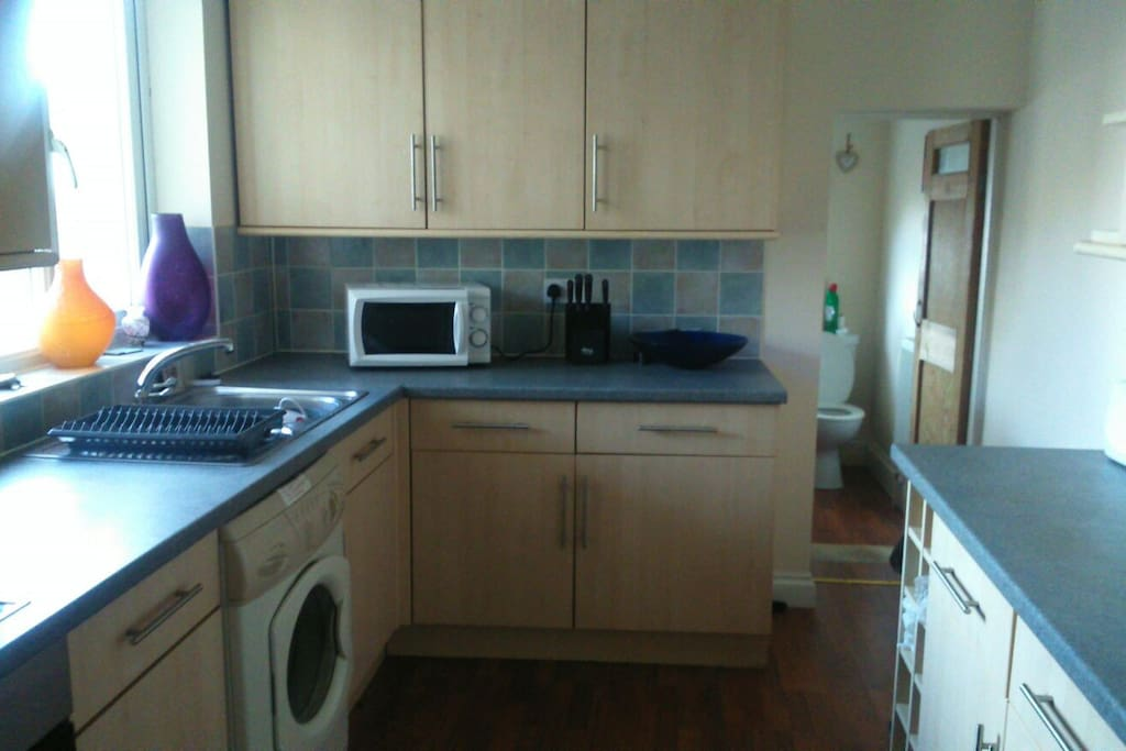 The kitchen and 2nd loo