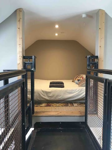 Double bed in open loft area