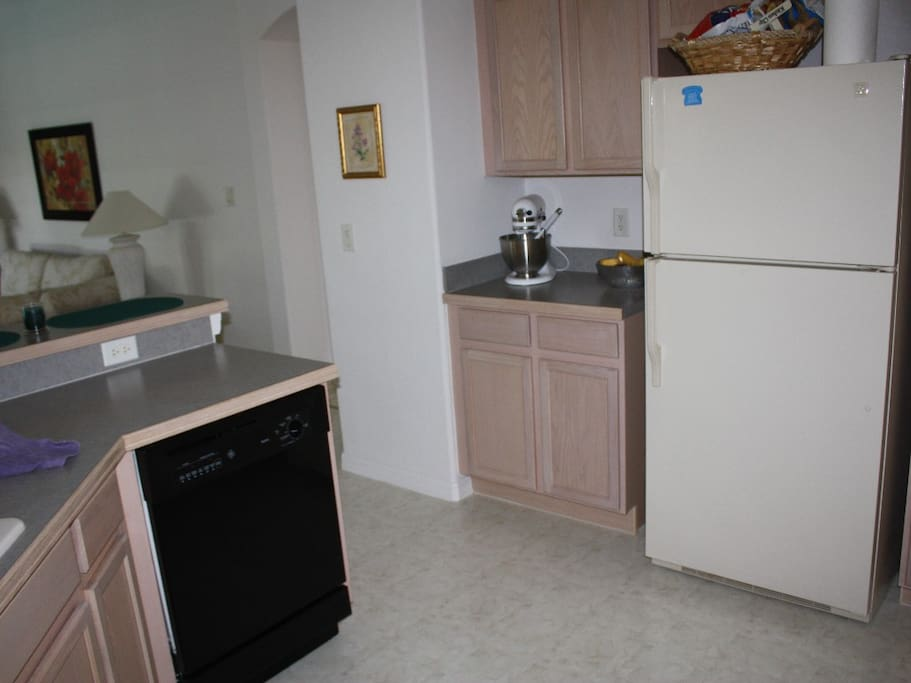Kitchen with dishwasher and refrigerator