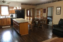 Kitchen island with 3 barstools to dine at the counter.  Large dining room table can seat up to 6 people.