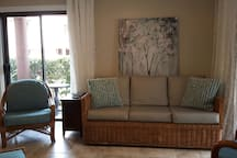 Aloha style living room with comfy furniture and ample seating spaces